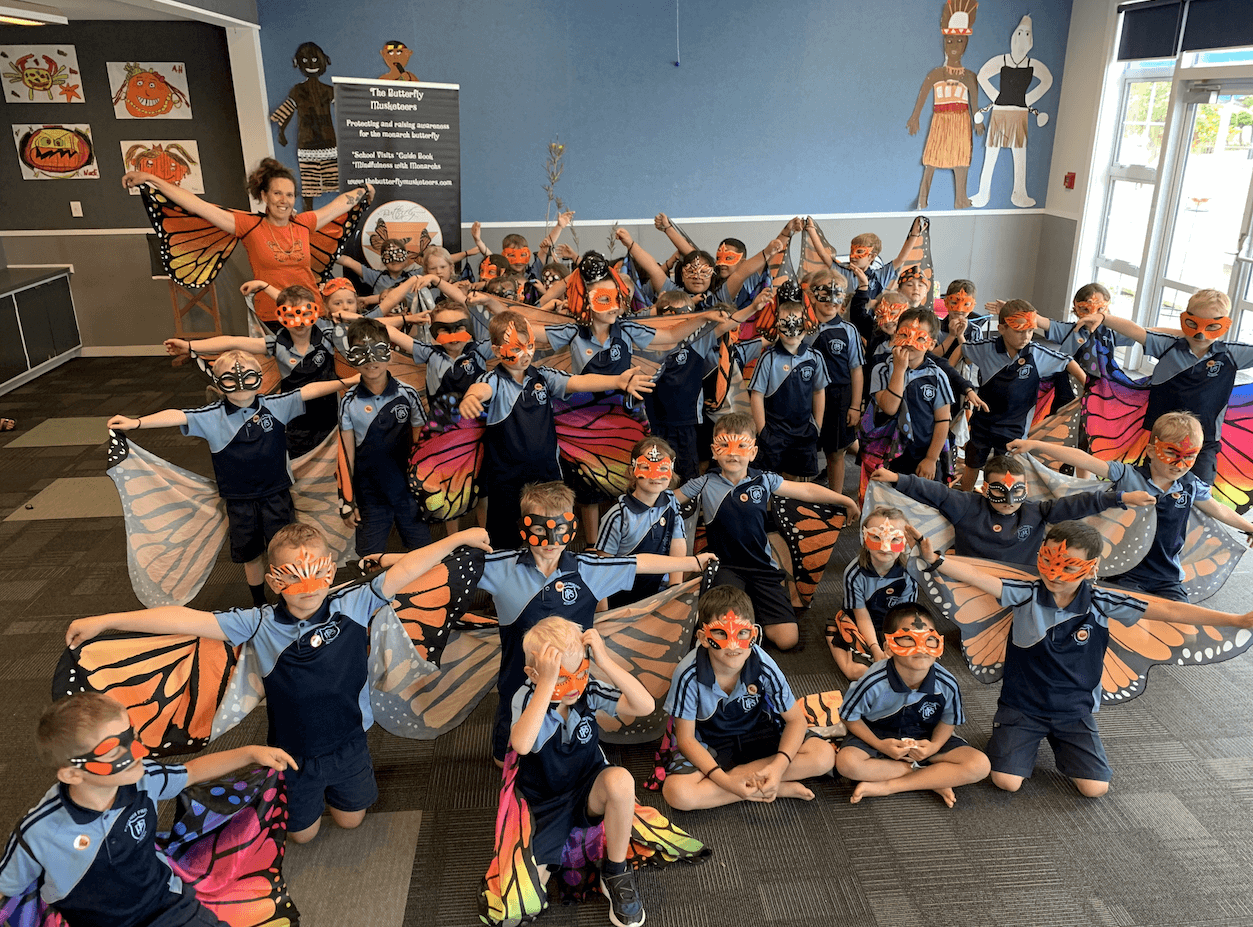 Papanui Primary School children wearing butterfly wings and masks