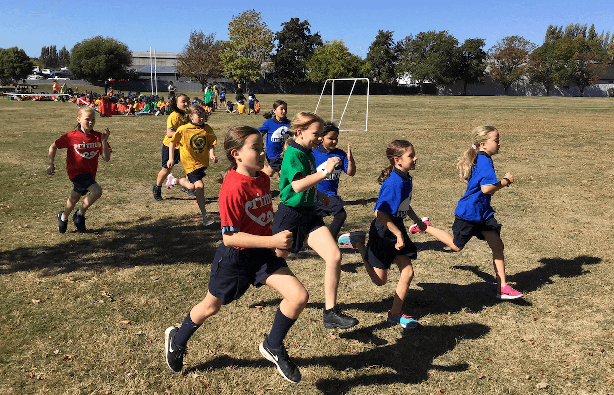 Papanui Primary students in house colours running a race
